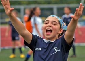 Cami Doumit of the U-14 Blue team celebrates a goal