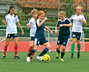 Halle Richards gains possession of the ball in a Coca-Cola League game