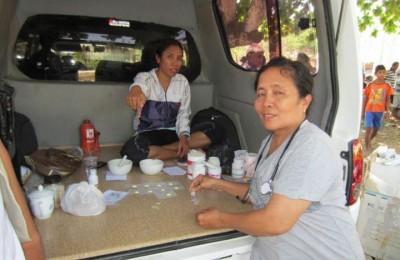 Dr Rani giving out meds