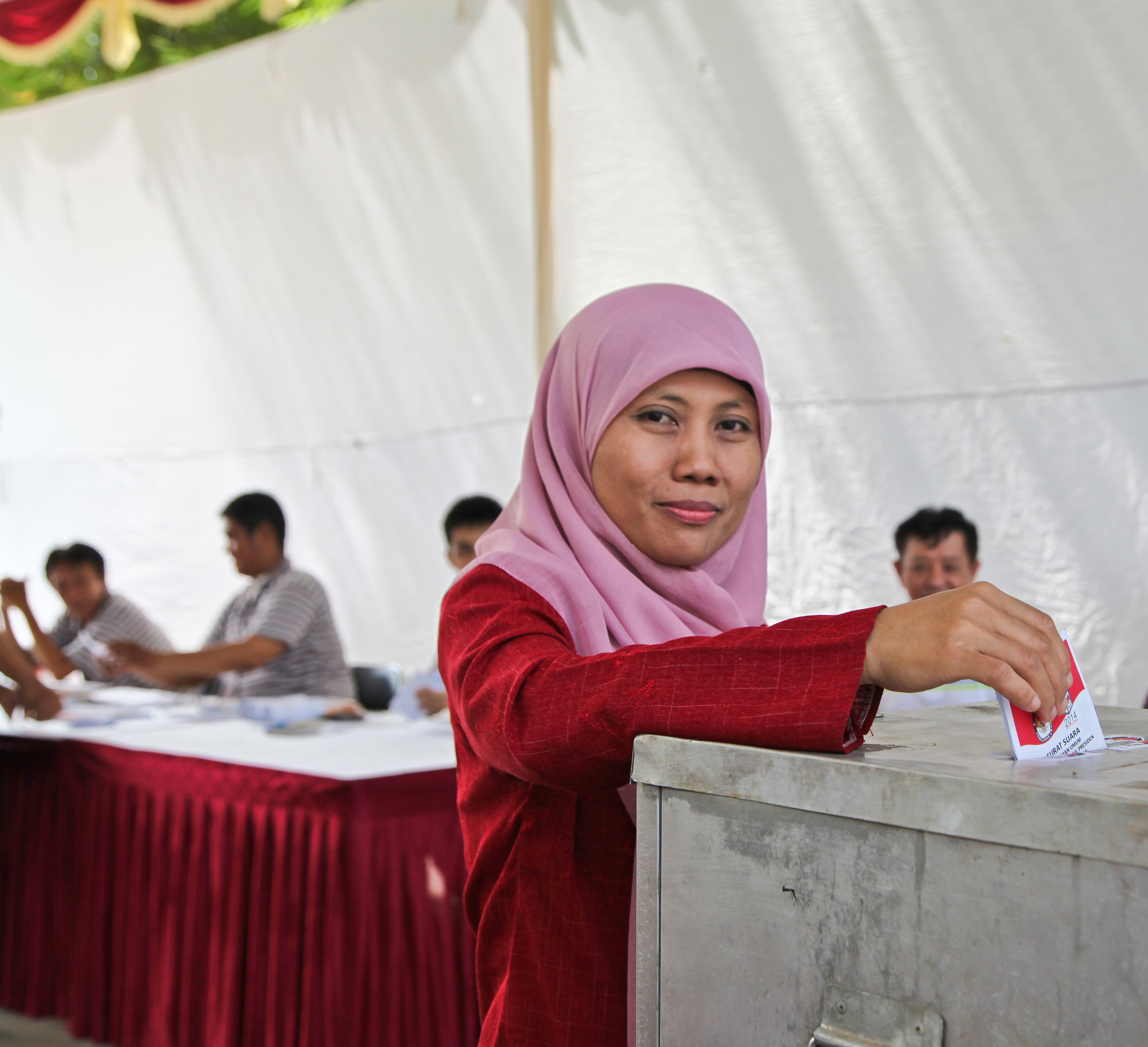 A woman casting her vote on July 9