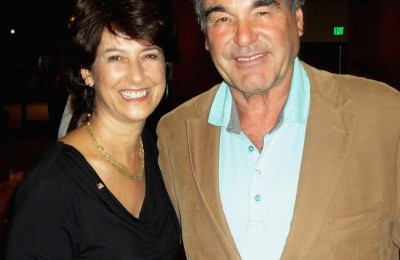 Deborah Gabinetti with Oliver Stones at the Film Premiere of SAVAGES.