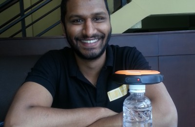 Hemant with his solar panel to drinking bottle light