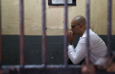 Former JIS teacher Neil Bantleman behind bars. Courtesy of CBC.