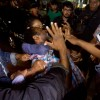 A Nigerian may is forcibly detained in an immigration raid in Jakarta. Photo courtesy of Antara