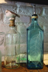 Re-used glass bottles engraved by local artisans make great gifts.