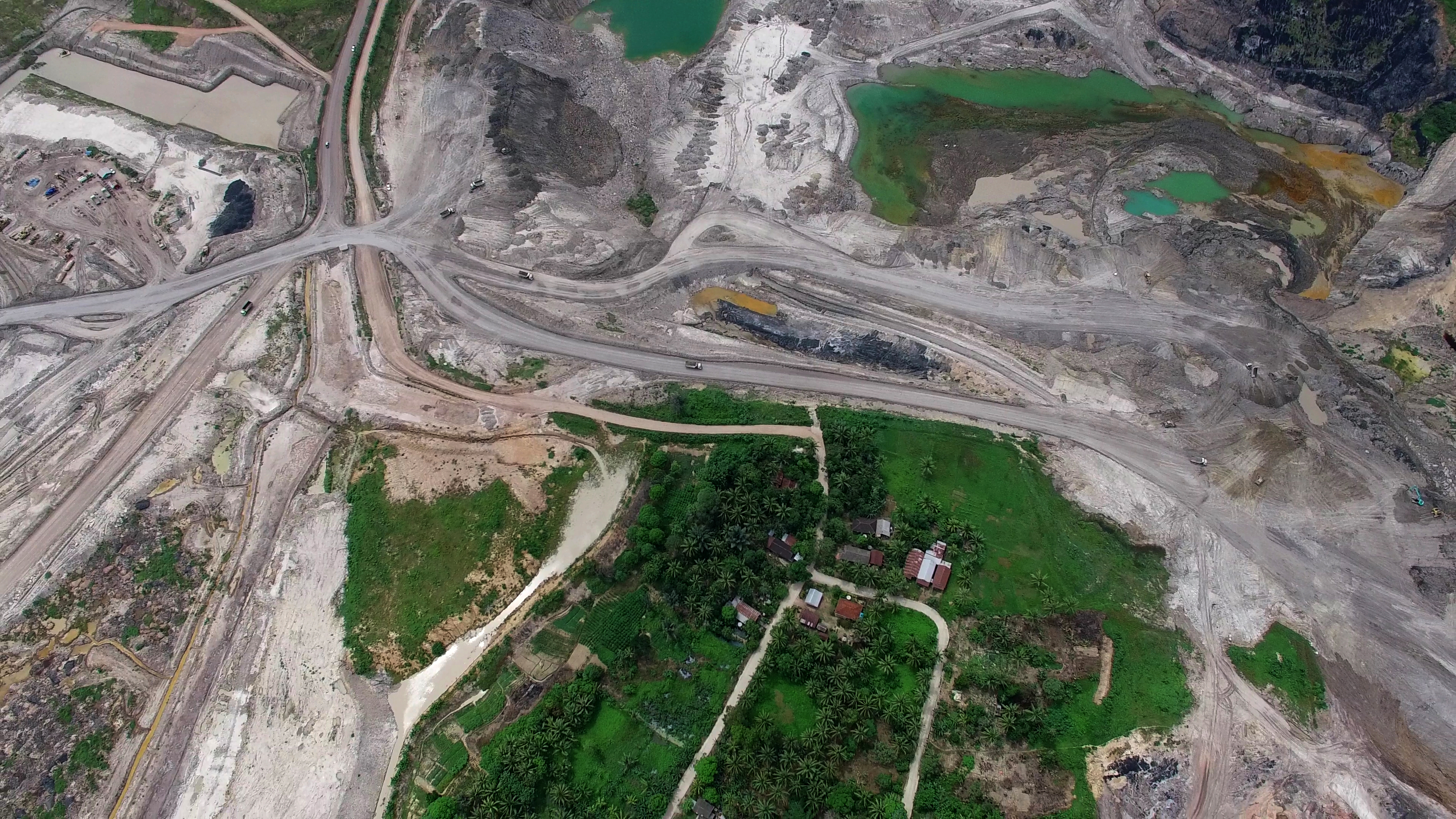 An image taken from a drone shows Kerta Buana village surrounded by a coal mine owned by Banpu Public Company Ltd group in Kutai Kartanegara, East Kalimantan. Greenpeace released an investigative report that shows how coal mining activities in East Kalimantan are destroying landscapes and polluting the water in the surrounding areas.