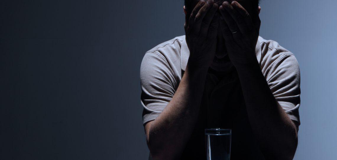 man-with-pill-aspirin-headache-depressed
