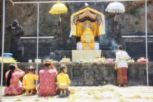 Family offering galungan prayers at hindu temple karangasem east-bali