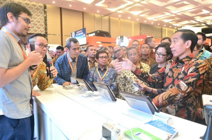 President Joko 'Jokowi' Widodo attends a fintech festival in Indonesia. Fintech startups, particularly P2P lending firms, are now required at least $260,000 capital, according to new regulations.