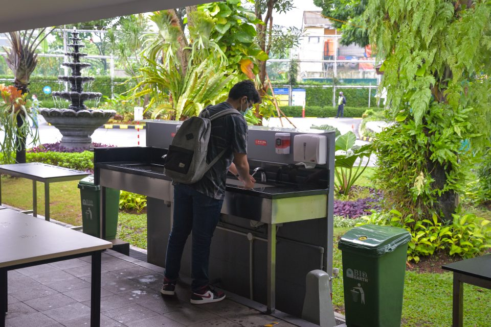 A JIS student washing their hands.